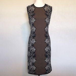Black, white, and tan dress